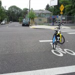 Advance bike stop lines at intersection with curb extensions.