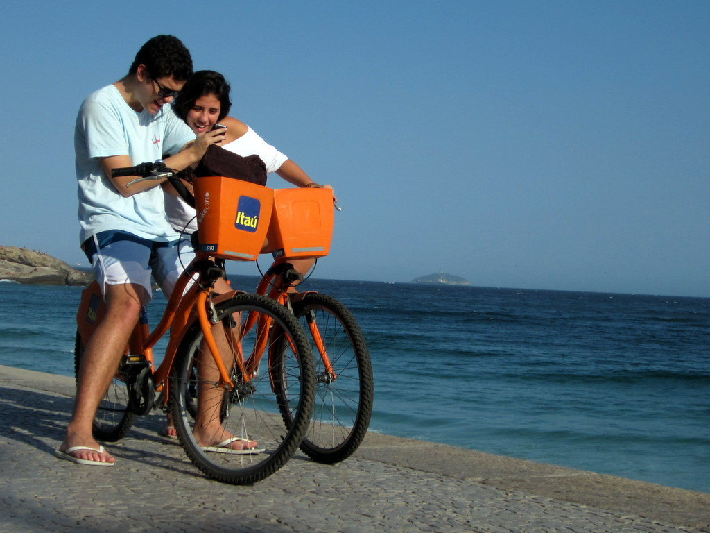 Enjoying Ipanema beach on a car free Sunday on a bike share bike..