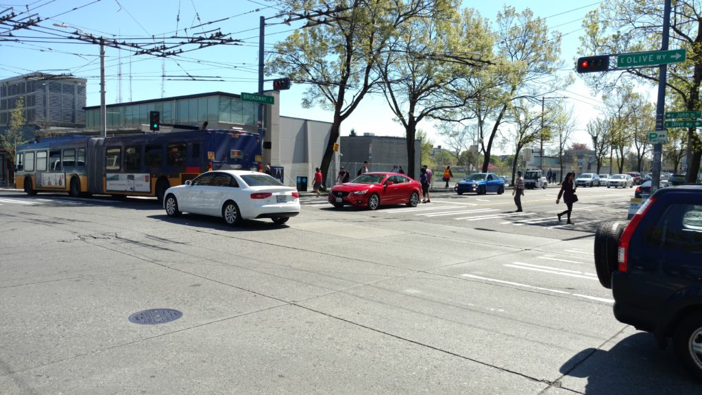 Left-turning car stuck in crosswalk, Broadway E & E John St / E Olive Way